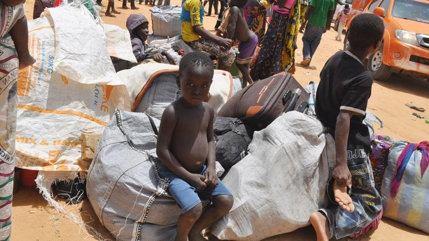 Nigeria refugees who were deported by Niger troops arrive in Gaidam, Nigeria Thursday, May 6, 2015.  Niger troops have deported more than 3,000 Nigerian fishermen and refugees escaping Boko Haram, forcing them to undertake a brutal three-day trek in which at least a dozen people died, an official and witnesses said Wednesday. Nigeria's National Emergency Management Agency's Charles Otegbabe said it was alerted by Niger and sent trucks to collect the exhausted refugees at the border, registering at least 3,000 new arrivals in Gaidam town and expect hundreds more. (AP Photo/Jossy Ola)