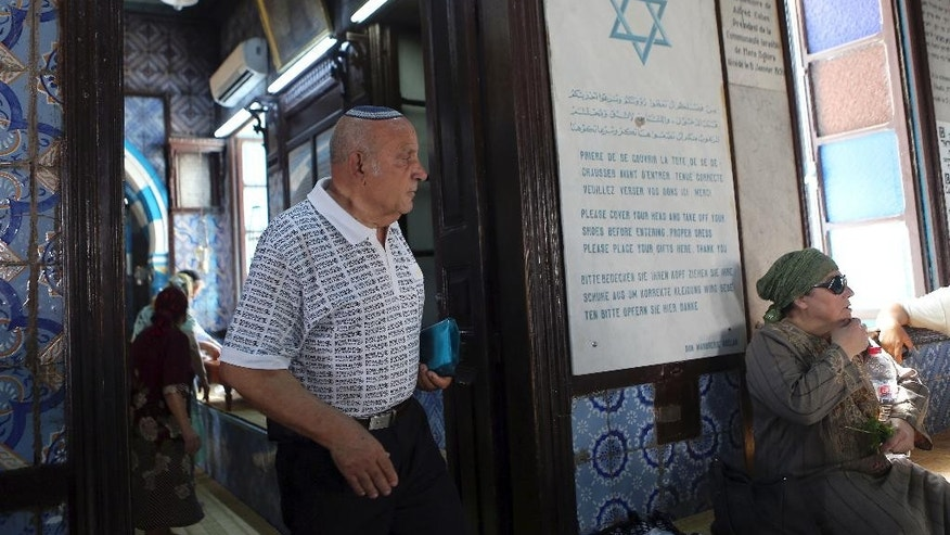 Tunisian Jew Joseph Yaacoub arrives at the Ghriba synagogue in Djerba, south Tunisia, Wednesday, May 6, 2015.  Pilgrims arrived for the pilgrimage at Tunisia's Ghriba synagogue, the oldest in Africa.  On April 11, 2002 a deadly attack on the synagogue killed 21 people, including 14 German tourists. (AP Photo/Mohsen May)