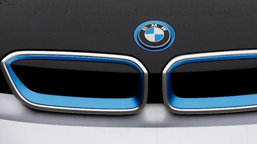 FILE- In this file photo dated Tuesday, Jan. 20, 2015, the logo of German car manufacturer BMW is pictured on a BMW i3 electric drive car at the production line in Dingolfing, Germany.  The world's leading maker of premium cars by volume, BMW is scheduled to report first-quarter business results on Wednesday May 6, 2015. (AP Photo/Matthias Schrader, FILE)