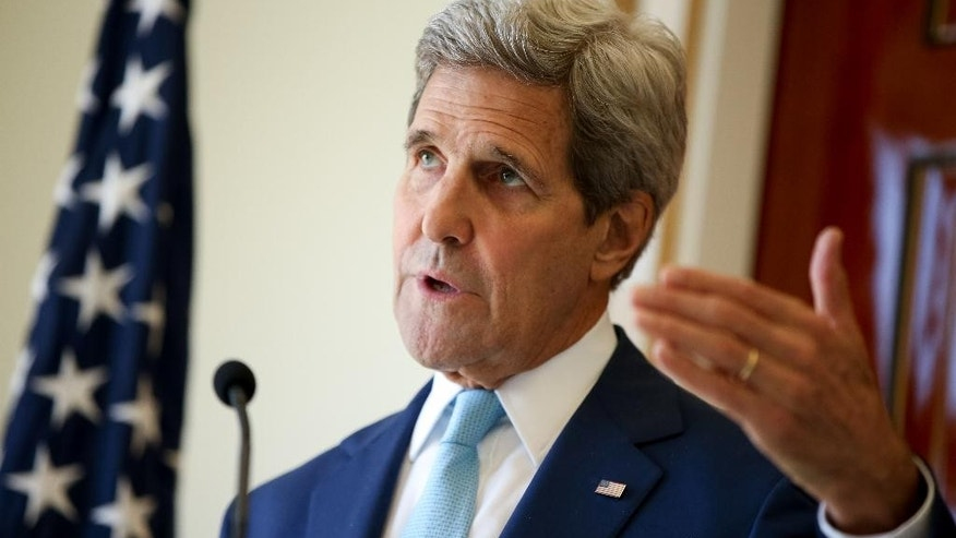 "U.S. Secretary of State John Kerry speaks during a joint press conference with Foreign Minister Mahamoud Ali Youssouf at the Presidential Palace, in Dijbouti, Dijbouti, Wednesday, May 6, 2015. Kerry said Wednesday he intends to discuss with Saudi Arabian officials how to implement a ""humanitarian pause"" in Yemen's civil war, citing increased shortages of food, fuel and medicine that are adding to a crisis that has already caused some thousands of people to flee to neighboring countries. Kerry is also visiting Sri Lanka, Somalia,  France, and Saudi Arabia on his trip.(AP Photo/Andrew Harnik, Pool)"