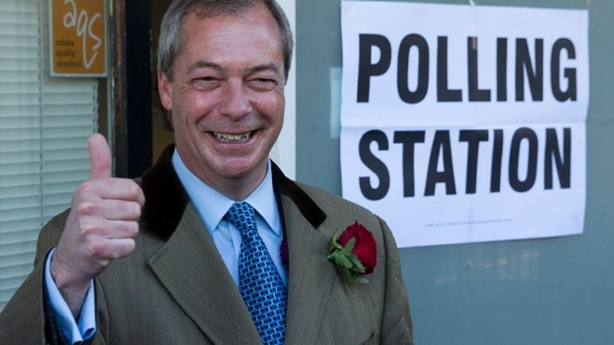 May 7, 2015: Nigel Farage the leader of the UK Independence Party (UKIP) poses for photographers as he arrives to cast his vote at a polling station in Ramsgate, southeast England. (AP)