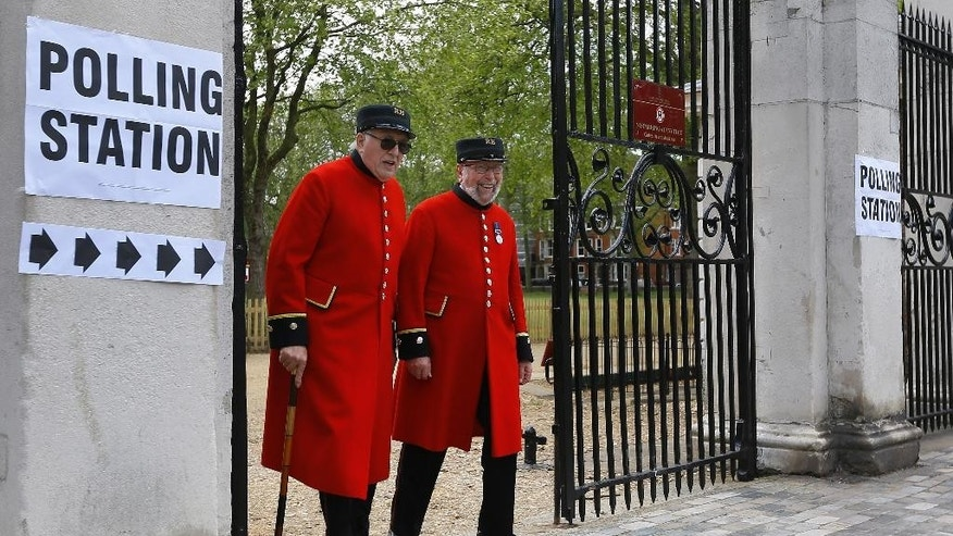 May 7, 2015: Chelsea Pensioners smile as they see the media after voting at a polling station in London.