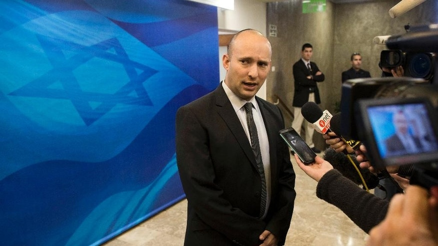 FILE - In this Sunday, Jan. 18, 2015 file photo, then Israeli Economy Minister Naftali Bennett speaks with the media ahead of a weekly cabinet meeting in Jerusalem. Bennett is slated to be minister of education in the emerging government, a post where he can infuse some of his world view in the Israeli school system. (AP Photo/Abir Sultan, Pool, File)