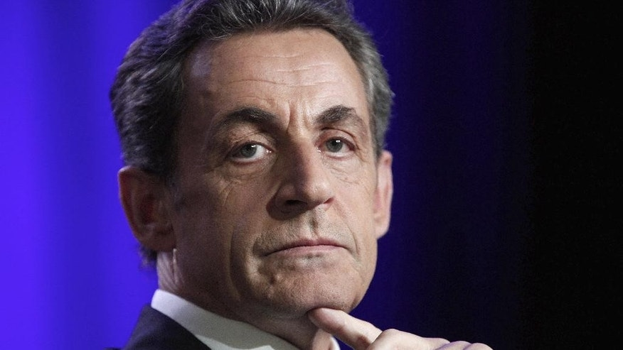 FILE - In this March 24, 2015 file photo, former French President and conservative party UMP leader Nicolas Sarkozy attends a meeting in Asnieres, outside Paris, France. The Paris appeals court has ruled Thursday May 7, 2015 that investigating judges didn't break any laws when they tapped conversations between former President Nicolas Sarkozy and his lawyer in connection with a probe into past campaign financing.(AP Photo/Thibault Camus, File)