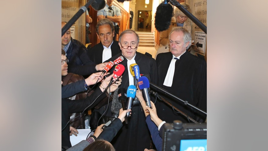 Nicolas Sarkozy' lawyer Pierre Haik, center,  with at his side Thierry Herzog's lawyers Philippe-Dehapiot, right, and Paul Albert Iweins, left, addresses reporters at Paris court house Thursday May 7, 2015; after the Paris appeals court has ruled that investigating judges didn't break any laws when they tapped conversations between former President Nicolas Sarkozy and his lawyer Thierry Herzog, in connection with a probe into past campaign financing. (AP Photo/Remy de la Mauviniere)