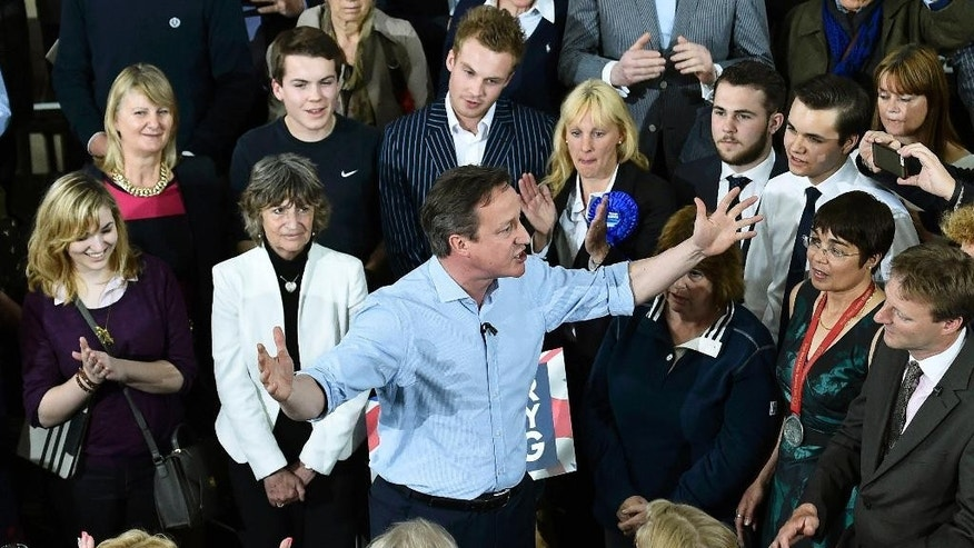 Britain's Prime Minister and Conservative Party leader David Cameron gestures as he speaks at an election rally in St Ives, southwest England Tuesday May 5, 2015. Britain will go to the polls in a national election on May 7. (Toby Melville/Pool Photo, Via AP)