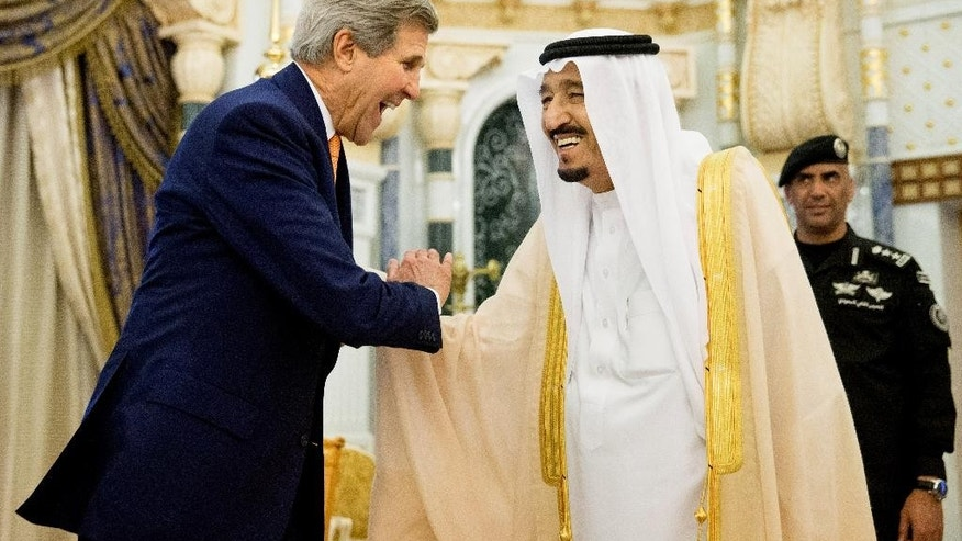 U.S. Secretary of State John Kerry, left, shakes hands with Saudi Arabia's King Salman at the Royal Court, in Riyadh, Saudi Arabia, Thursday, May 7, 2015. Kerry sought to secure a pause in Yemen's war after he arrived to Saudi Arabia to meet with the king and other top officials, citing increased shortages of food, fuel and medicine that are adding to a crisis that already has neighboring countries bracing for a mass exodus of refugees. (AP Photo/Andrew Harnik, Pool)