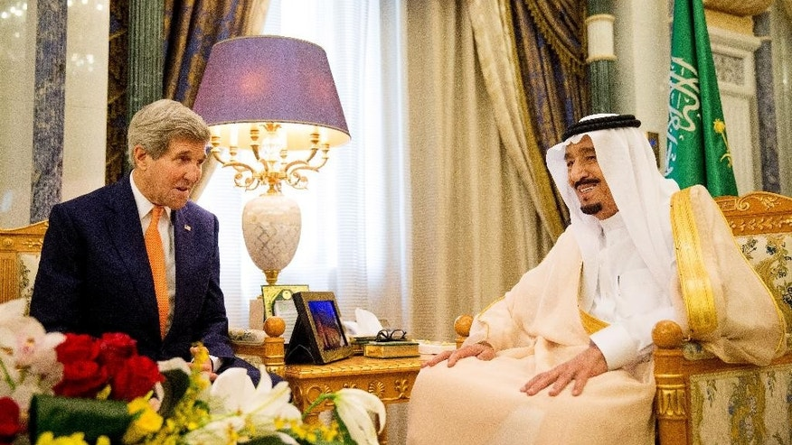 U.S. Secretary of State John Kerry, left, meets with Saudi Arabia's King Salman at the Royal Court, in Riyadh, Saudi Arabia, Thursday, May 7, 2015. Kerry sought to secure a pause in Yemen's war after he arrived to Saudi Arabia to meet with the king and other top officials, citing increased shortages of food, fuel and medicine that are adding to a crisis that already has neighboring countries bracing for a mass exodus of refugees. (AP Photo/Andrew Harnik, Pool)
