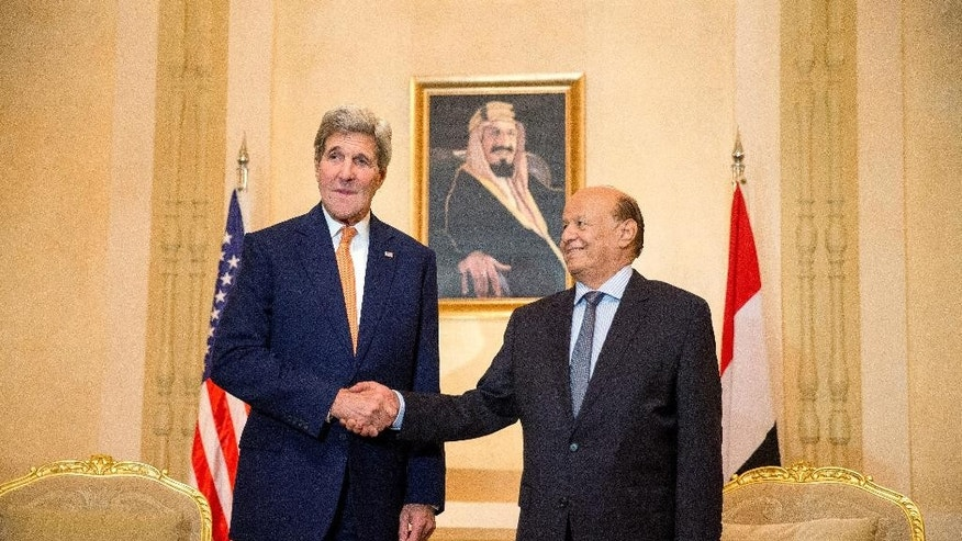 U.S. Secretary of State John Kerry, left, shakes hands with President of Yemen Abd Rabbo Mansour Hadi, for photographs, at the Al-Nasarieh Guest Palace in Riyadh, Saudi Arabia, Thursday, May 7, 2015. Kerry sought to secure a pause in Yemen's war after he arrived to Saudi Arabia to meet with the king and other top officials, citing increased shortages of food, fuel and medicine that are adding to a crisis that already has neighboring countries bracing for a mass exodus of refugees. (AP Photo/Andrew Harnik, Pool)