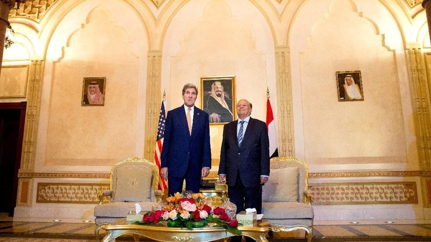 U.S. Secretary of State John Kerry, left, poses for photographs with President of Yemen Abd Rabbo Mansour Hadi, at the Al-Nasarieh Guest Palace in Riyadh, Saudi Arabia, Thursday, May 7, 2015. Kerry sought to secure a pause in Yemen's war after he arrived to Saudi Arabia to meet with the king and other top officials, citing increased shortages of food, fuel and medicine that are adding to a crisis that already has neighboring countries bracing for a mass exodus of refugees. (AP Photo/Andrew Harnik, Pool)