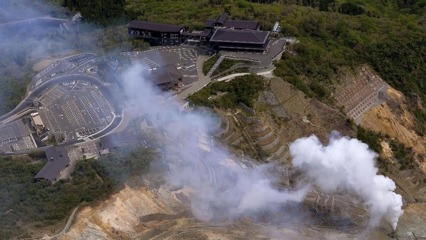 White smoke is spewed out in Owakudani valley of Mount. Hakone where increased earthquake activity is found, in Hakone town, about 80 kilometers (50 miles) southwest of Tokyo, Thursday, May 7, 2015. Japanese authorities have closed part of the popular hot springs area to the public because of fears a volcano might erupt. (Kyodo News via AP) JAPAN OUT, CREDIT MANDATORY