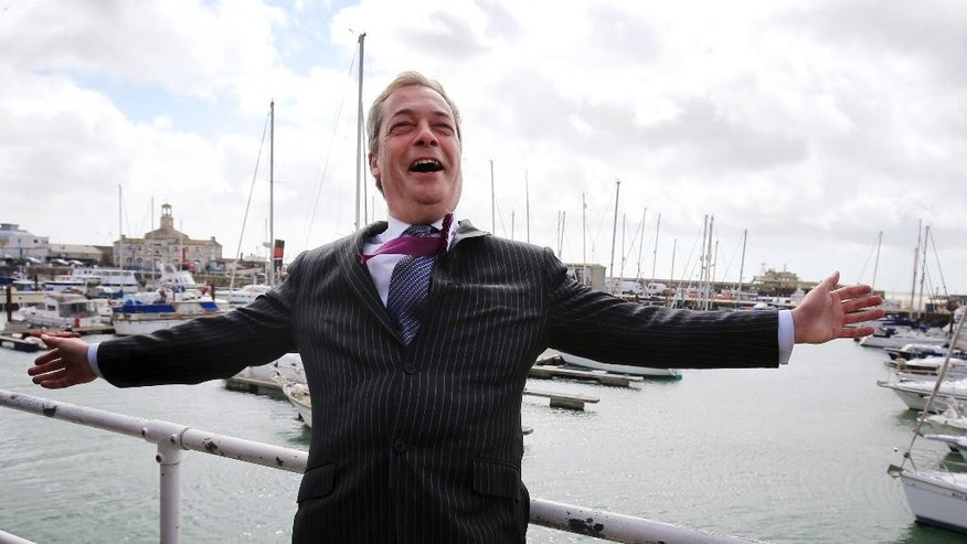 UK Independence Party leader Nigel Farage enjoys the sea breeze as he looks out over the harbour during a walk about in Ramsgate, south England, on the final day of his campaign trail, Wednesday May 6, 2015. Britain's political candidates are campaigning all across Britain in search of votes ahead of the May 7 General Election.  (Gareth Fuller / PA via AP) UNITED KINGDOM OUT - NO SALES - NO ARCHIVES