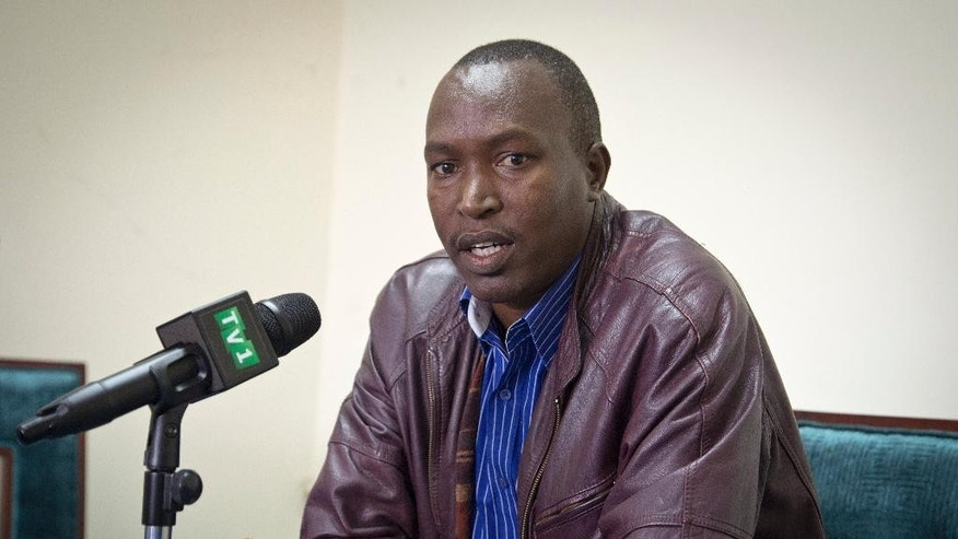 Exiled Vice President of Burundi's constitutional court, Sylvere Nimpagaritse, speaks to the media in Kigali, Rwanda Thursday, May 7, 2015. Nimpagaritse, who is in exile in Rwanda, said Thursday that the Burundian constitutional court was forced to validate President Pierre Nkurunziza's bid to seek a third term in office after the judges started receiving threatening phone calls which forced him to flee and the remaining judges to change their decision in Nkurunziza's favor. (AP Photo/Denyse Uwera)
