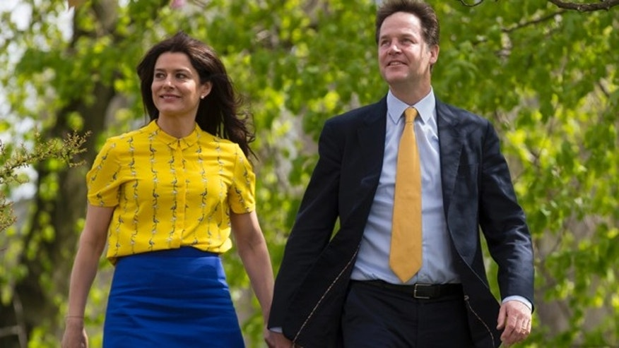 May 7, 2015: Liberal Democrat  leader Nick Clegg and his wife Miriam Gonzalez Durantez arrive to vote at the Hall Park Centre in Sheffield, England as Britain takes to the polls in a general election. (AP Photo/Jon Super)