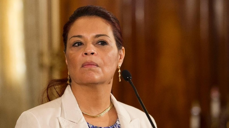 FILE - In this April 19, 2015 file photo, Guatemala's Vice President Roxana Baldetti listens to a question from journalists during a press conference at the presidential house in Guatemala City.  President Otto Perez Molina announced Friday, May 8, 2015, that Baldetti will leave office. She is resigning amid a customs corruption scandal that has implicated her former private secretary. (AP Photo/Moises Castillo, File)