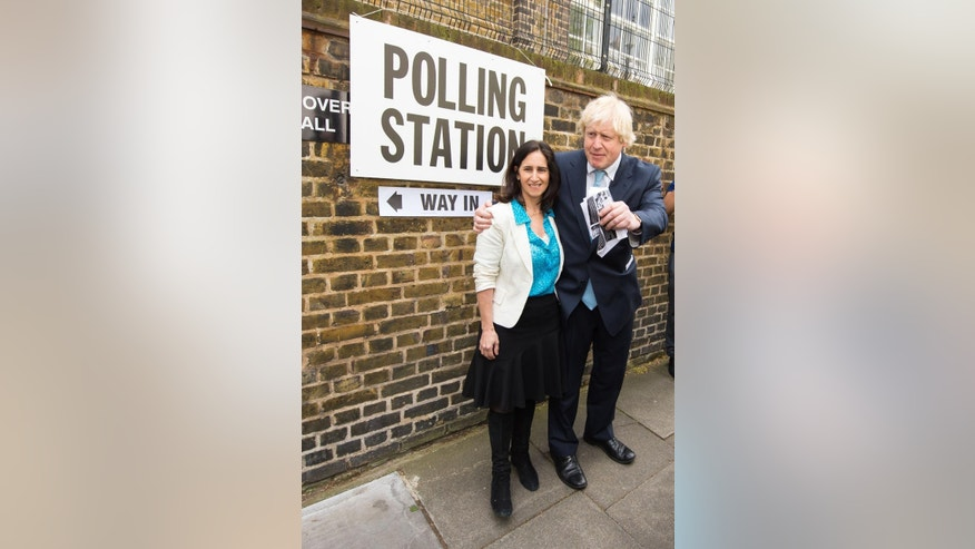 The Mayor of London, Boris Johnson and his wife Marina Wheeler leave a polling station in Islington, north London, after voting the in the General Election, Thursday May 7, 2015. Britain's national election is expected to produce an ambiguous result, a period of frantic political horse-trading and a bout of national soul-searching. (Dominic Lipinski/PA via AP)  UNITED KINGDOM OUT  NO SALES  NO ARCHIVE