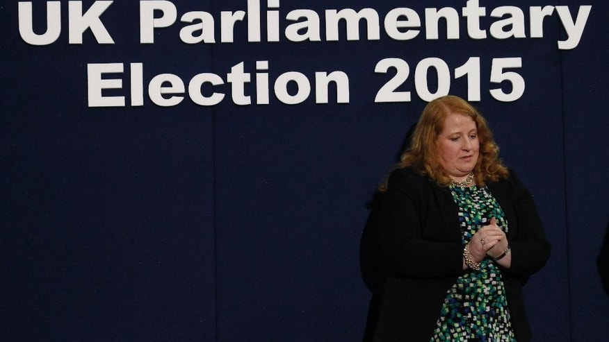 East Belfast Alliance party candidate Naomi Long reacts after losing her East Belfast seat during the election results for the UK general election at the Kings Hall count center in Belfast, Northern Ireland, Friday, May 8, 2015.  (AP Photo/Peter Morrison)