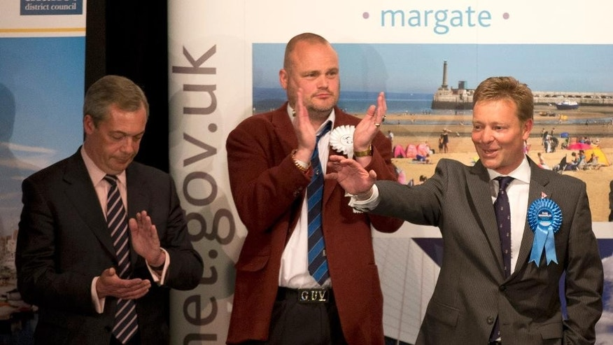 "The Conservative Party's Craig Mackinlay, right, waves after winning the count for the South Thanet seat beside, from left,  Nigel Farage the leader of the UK Independence Party (UKIP) and Al Murray a comedian who performs as ""The Pub Landlord"" at the Winter Gardens in Margate, south east England, Friday, May 8, 2015. British Prime Minister David Cameron appeared poised to remain in power Friday, with early British election results and exit polls indicating his Conservatives had won a resounding victory and will return to 10 Downing Street in a stronger position than before. (AP Photo/Matt Dunham)"