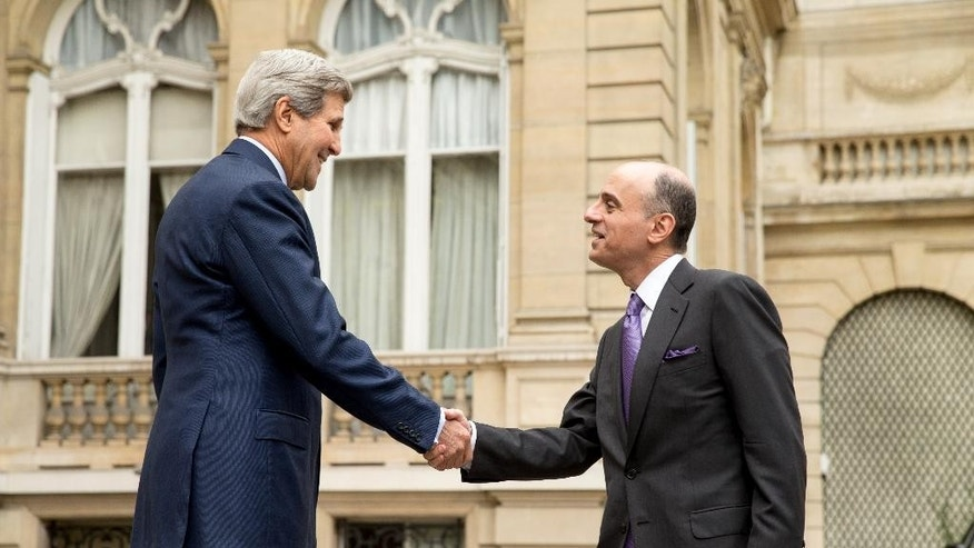 Secretary of State John Kerry shakes hands with Saudi Foreign Minister Adel al-Jubeir outside of the Chief of Mission Residence in Paris, France, Friday, May 8, 2015, before a meeting with the foreign ministers of the Gulf Cooperation Council held to discuss Middle East concerns about an emerging nuclear deal with Iran. Kerry has also visited Sri Lanka, Somalia, Djibouti, Kenya, and Saudi Arabia on his trip. (AP Photo/Andrew Harnik, Pool)