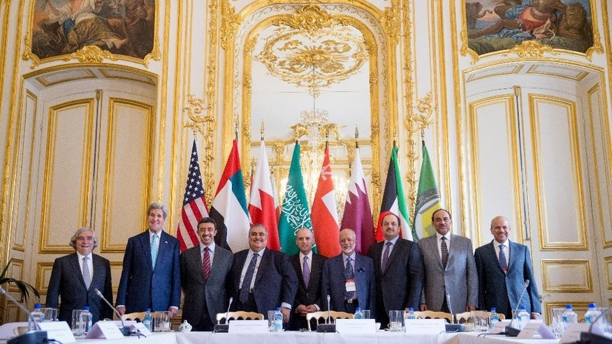 Secretary of State John Kerry and Foreign Ministers of the Gulf Cooperation Council pose for photographers at the Chief of Mission Residence in Paris, France, Friday, May 8, 2015, to discuss Middle East concerns about an emerging nuclear deal with Iran. Kerry has also visited Sri Lanka, Somalia, Djibouti, Kenya, and Saudi Arabia on his trip. (AP Photo/Andrew Harnik, Pool)