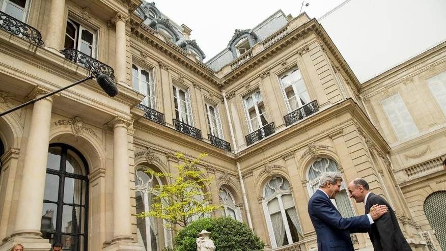 Secretary of State John Kerry greets Saudi Foreign Minister Adel al-Jubeir outside of the Chief of Mission Residence in Paris, France, Friday, May 8, 2015, before a meeting with the foreign ministers of the Gulf Cooperation Council held to discuss Middle East concerns about an emerging nuclear deal with Iran. Kerry has also visited Sri Lanka, Somalia, Djibouti, Kenya, and Saudi Arabia on his trip. (AP Photo/Andrew Harnik, Pool)