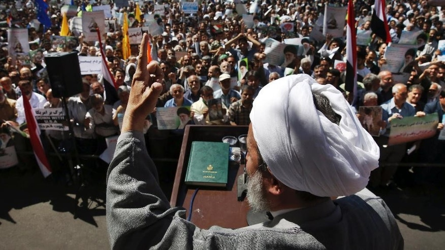 "Iranian cleric Alireza Panahian addresses the crowd in a protest rally to denounce the Saudi-led strikes on Yemen, at the Felestin (Palestine) Sq, in Tehran, Iran, Friday, May 8, 2015. Up to 6,000 protesters took to the streets after Friday prayers in the Iranian capital, Tehran, to denounce the Saudi-led strikes. The crowd chanted ""death to America"" and ""Death to the Saud family,"" which rules the kingdom. Iran has backed the Houthis though both the Shiite powerhouse and the rebels deny the support includes military equipment and weapons. (AP Photo/Vahid Salemi)"