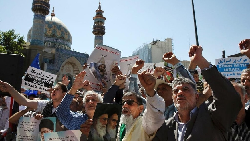 "Iranian protestors chant slogans in a rally to denounce the Saudi-led strikes on Yemen, at the Felestin (Palestine) Sq., in Tehran, Iran, Friday, May 8, 2015. Up to 6,000 protesters took to the streets after Friday prayers in the Iranian capital, Tehran, to denounce the Saudi-led strikes. The crowd chanted ""death to America"" and ""Death to the Saud family,"" which rules the kingdom. Iran has backed the Houthis though both the Shiite powerhouse and the rebels deny the support includes military equipment and weapons. (AP Photo/Vahid Salemi)"