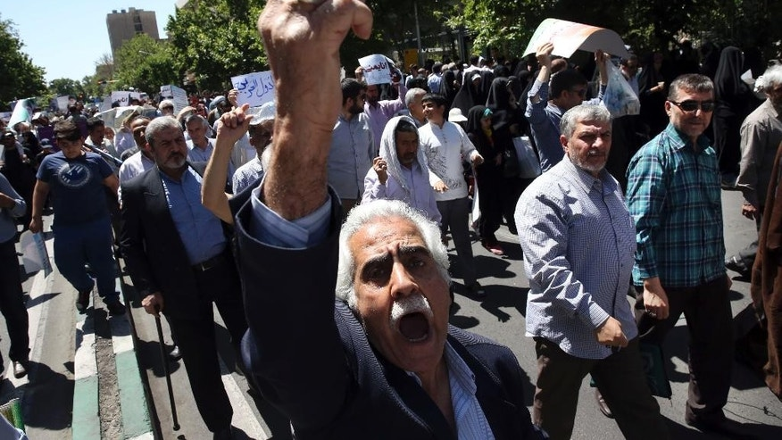 "An Iranian protestor chants a slogan in a rally to denounce the Saudi-led strikes on Yemen, in Tehran, Iran, Friday, May 8, 2015. Up to 6,000 protesters took to the streets after Friday prayers in the Iranian capital, Tehran, to denounce the Saudi-led strikes. The crowd chanted ""death to America"" and ""Death to the Saud family,"" which rules the kingdom. Iran has backed the Houthis though both the Shiite powerhouse and the rebels deny the support includes military equipment and weapons. (AP Photo/Vahid Salemi)"