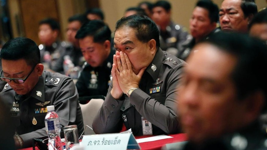 Thai policemen listen to Thai Police chief Gen. Somyot Poompanmoung during a meeting about Anti Human Trafficking at the police headquarters in Bangkok, Thailand , Friday, May 8, 2015. Thailand's national police chief said a powerful mayor was arrested Friday and that more than 50 police officers were under investigation in the country's widening human-trafficking scandal. (AP Photo/Sakchai Lalit)