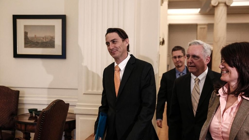 Amos Hochstein, centre, U.S. State Department Special Envoy for International Energy Affairs, is escorted by U.S. Ambassador to Athens David D. Pearce, second right, as they arrive for a meeting with Greek Foreign Minster Nikos Kotzias in Athens, Greece, on Friday, May 8, 2015. Hochstein is in Athens to hold talks with government officials over energy issues.  (AP Photo/Yorgos Karahalis)