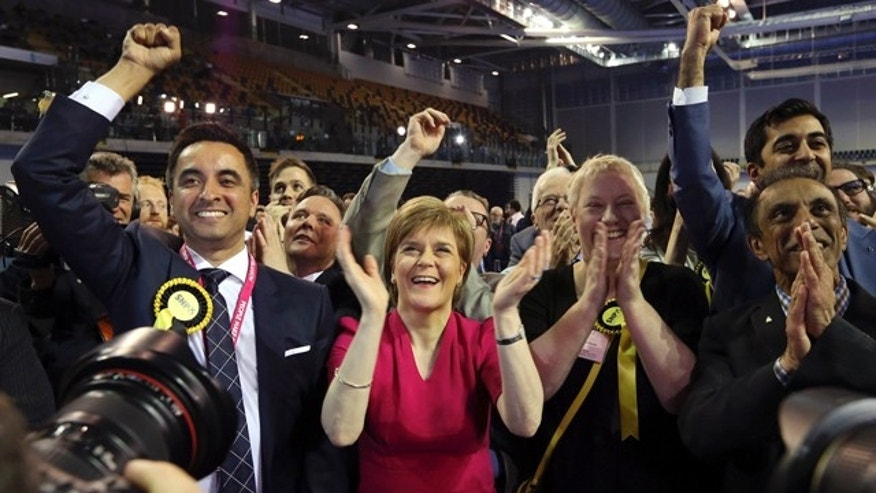 May 8, 2015: First Minister of Scotland and Scottish National Party leader Nicola Sturgeon, center, celebrates with the results for her party at the count of Glasgow constituencies for the general election. (AP Photo/Scott Heppell)