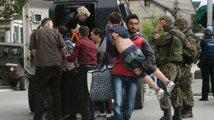 May 9, 2015: People are evacuated safely from the scene of an altercation involving the police, in northern Macedonian town of Kumanovo. (AP)