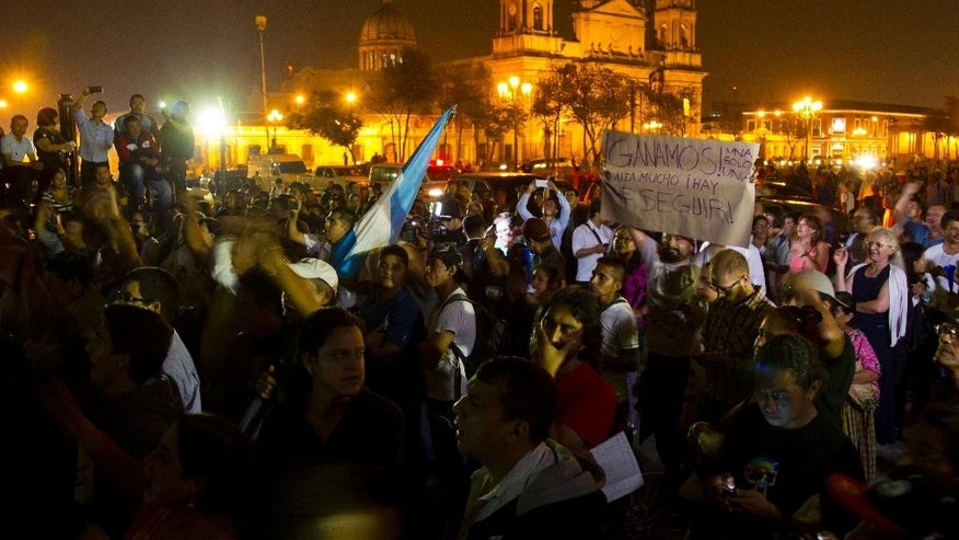 Protesters demand the resignation of Guatemalan President Otto Perez Molina near Congress in Guatemala City, Saturday, May 9, 2015. Perez Molina's Vice President Roxana Baldetti resigned on Friday amid a customs corruption scandal that has implicated her former private secretary. (AP Photo/Moises Castillo)