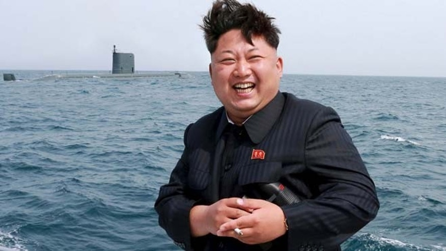 May 9: North Korean leader Kim Jong Un watches the test-fire of a strategic submarine underwater ballistic missile (not pictured), in this undated photo released by North Korea's Korean Central News Agency in Pyongyang.