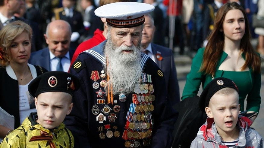 Georgy Shirokov, 91, Russian veteran of WWII and former sailor of the Baltic Fleet walks in Red Square before the Victory Parade, celebrating 70 years after WWII, in Moscow, Russia, Saturday, May 9, 2015. (AP Photo/Alexander Zemlianichenko)