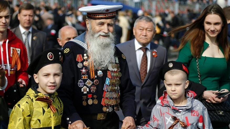 Georgy Shirokov, 91, a Russian veteran of WWII and former sailor of the Baltic Fleet walks in Red Square before the Victory Parade, celebrating 70 years after WWII, in Moscow, Russia, Saturday, May 9, 2015. (AP Photo/Alexander Zemlianichenko)