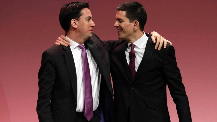 FILE - In this Monday, Sept. 27, 2010, file photo, Ed Miliband, left, the then newly-elected leader of Britain's opposition Labour Party, embraces his brother David Miliband, right, following David's speech on foreign policy during the party's annual conference, in Manchester, England. They were two young, very talented brothers with the world to play for. The older one was poised to become leader of Britain's Labour Party, with a chance to become prime minister, the other was expected to rise with his brother to the highest ranks of the country's fever-pitched political arena. But things didn't go this way for David and Ed Miliband in 2010. Ed didn't want to take a back seat to his more polished and articulate older brother and shocked the political world by challenging David for the leadership role and triumphing _ or so it seemed.(AP Photo/Lefteris Pitarakis, File)