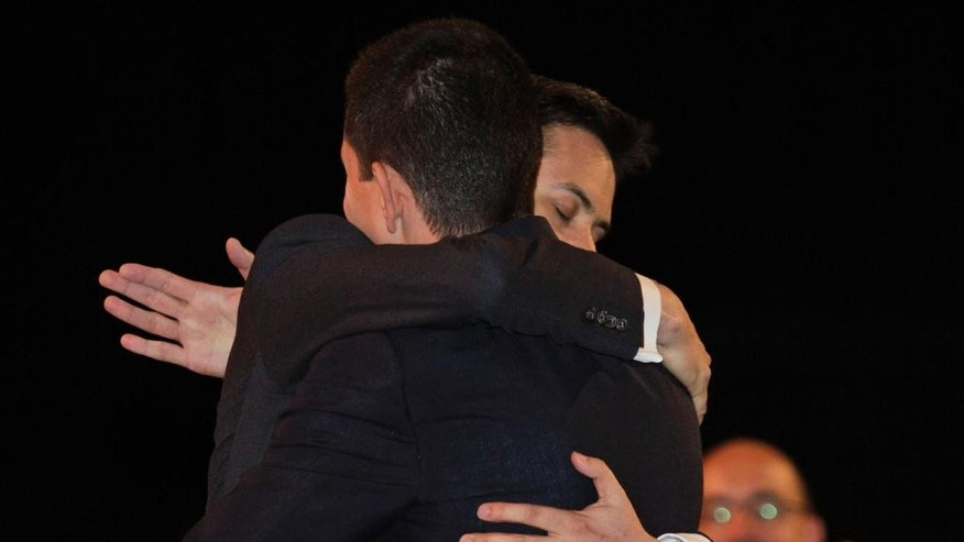 FILE - In this Saturday, Sept. 25, 2010 file photo,  Ed Miliband, right, the then newly-elected leader of Britain's opposition Labour Party, embraces his brother David Miliband, back on camera, who was also a candidate, following the announcement at the start of the party's annual conference, in Manchester, England. They were two young, very talented brothers with the world to play for. The older one was poised to become leader of Britain's Labour Party, with a chance to become prime minister, the other was expected to rise with his brother to the highest ranks of the country's fever-pitched political arena. But things didn't go this way for David and Ed Miliband in 2010. Ed didn't want to take a back seat to his more polished and articulate older brother and shocked the political world by challenging David for the leadership role and triumphing _ or so it seemed. (AP Photo/Lefteris Pitarakis, File)
