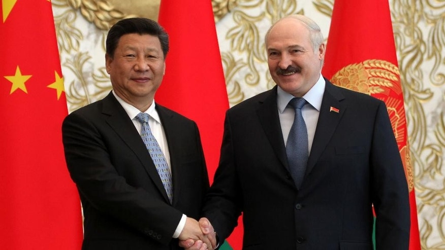 Belarus President Alexander Lukashenko, right, and Chinese President Xi Jinping shake hands at their meeting in Minsk, Belarus, Sunday, May 10, 2015. Chinese President Xi Jinping traveled Sunday to Belarus for a three-day trip to sign deals worth billions of dollars as Beijing looks to build greater inroads into Europe's economy. (AP Photo/Dmitry Brushko)