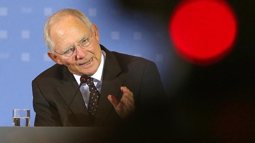 German Finance Minister  Wolfgang Schaeuble speaks during a news conference in Berlin, on Thursday May 7,2015. (Wolfgang Kumm/dpa via AP)