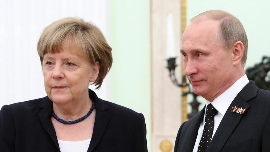 German Chancellor Angela Merkel, left, and Russian President Vladimir Putin meet in the Kremlin in Moscow, Russia, Sunday, May 10, 2015. Angela Merkel attended a wreath-laying ceremony at the Tomb of the Unknown Soldier, marking the 70th anniversary of the defeat of the Nazis in World War II, in Moscow. (Sergei Karpukhin/Pool Photo via AP)