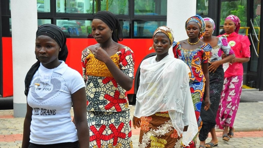 "FILE-In this file photo taken on Tuesday, July 22, 2014, school girls who escaped abduction from the Chibok government secondary school arrive for a meeting with Nigeria President Goodluck Jonathan, in Abuja, Nigeria.  The taunts wouldn't stop. ""Boko Haram wives,"" the schoolgirls were called because they had been briefly held by Nigeria's Islamic extremists before escaping. The teasing was so relentless that some of the Chibok girls left their town and families. (AP Photo, File)"