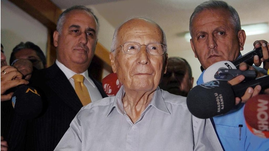 FILE – In this Sept. 12, 2010 file photo, Kenan Evren, the leader of Sept. 12 coup, casts his ballot during a referendum in Ankara, Turkey. Kenan Evren, the Turkish general who led a 1980 military coup that ended years of violence but whose rule unleashed a wave of arrests, torture and extrajudicial killings, died Saturday May 9, 2015. He was 97. (AP Photo/File)