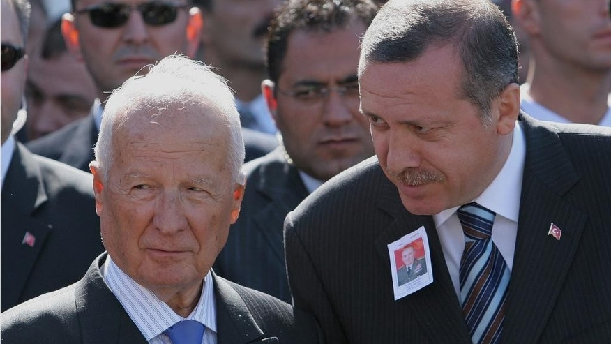 FILE - In this Oct. 5, 2005 file photo, Kenan Evren, the leader of Turkey's 1980 military coup and former president, left, listens to Turkish Prime Minister Recep Tayyip Erdogan during a funeral ceremony for Nurettin Ersin, former Land Force commander and one of five members of the military junta formed after the coup, at the Kocatepe Mosque in Ankara, Turkey. Kenan Evren, the Turkish general who led a 1980 military coup that ended years of violence but whose rule unleashed a wave of arrests, torture and extrajudicial killings, has died. He was 97. (AP Photo/Burhan Ozbilici, File])
