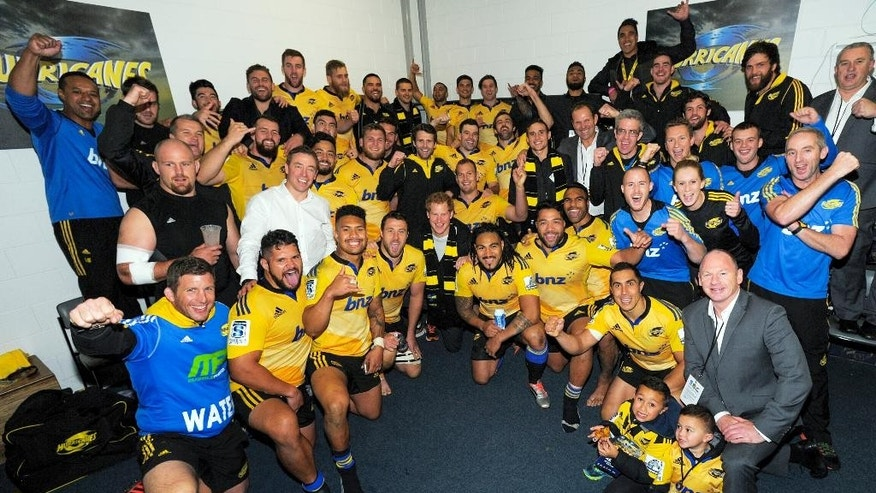 Britain's Prince Harry, center, poses with the Hurricanes team in the changing rooms after the Super Rugby match against the Sharks at Westpac Stadium in Wellington, New Zealand, Saturday, May 9, 2015. (Dave Lintott/Pool Photo via AP)