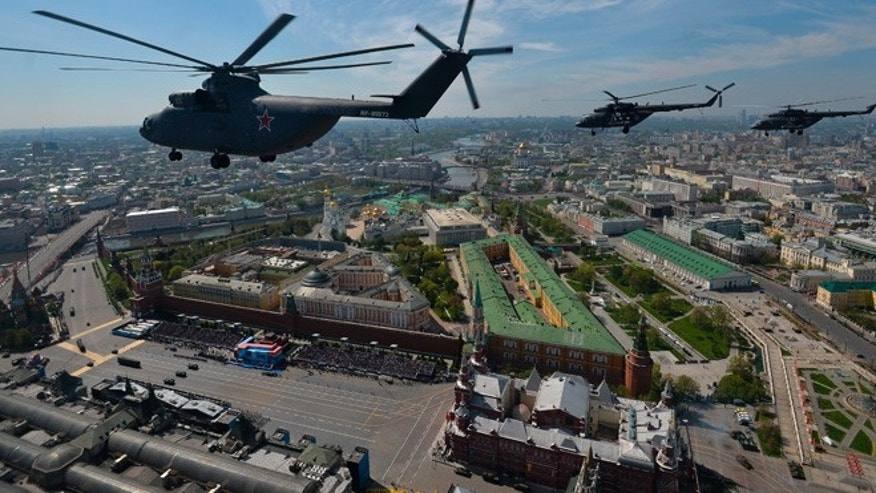 May 9, 2015: A Russian air force Mi-26 helicopter, front, flies over Red Square during the Victory Parade marking the 70th anniversary of the defeat of the Nazis in World War II, in Red Square in Moscow, Russia. (AP)