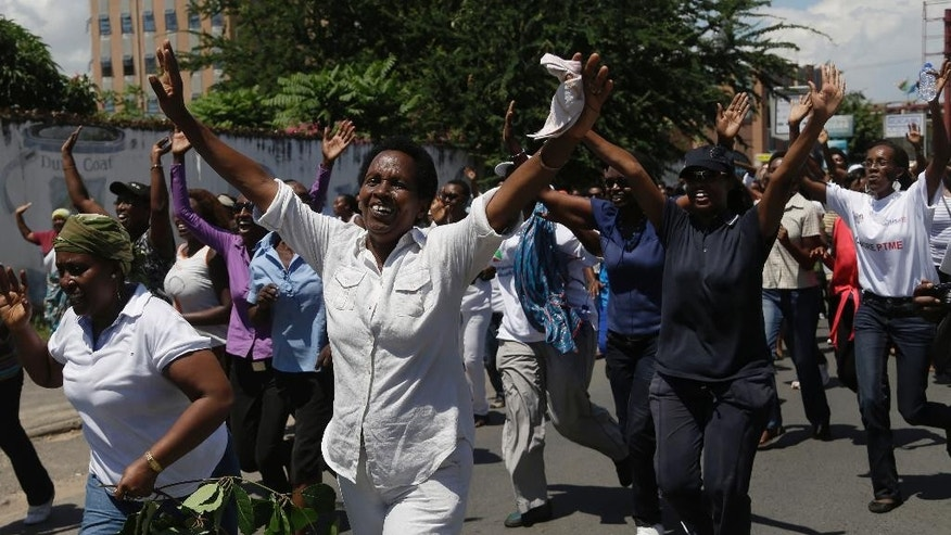 A group of over 250 women march through the center of Bujumbura, Burundi, calling for the release of protesters arrested during demonstrations, Sunday May 10, 2015. At least 13 people have died and 216 have been wounded in protests since April 25, when the ruling party announced it had nominated President Pierre Nkurunziza as its presidential candidate. (AP Photo/Jerome Delay)
