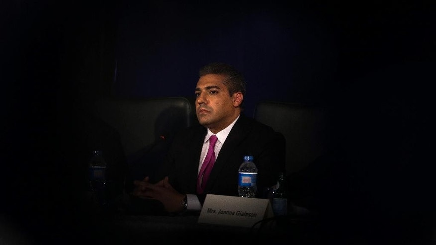 Al-Jazeera English's former acting bureau chief, Canadian-Egyptian journalist Mohammed Fahmy, speaks during a press conference in Cairo, Egypt, Monday, May 11, 2015. Fahmy who is facing terrorism-related charges in Egypt said he has filed a lawsuit against the Al-Jazeera network in Canada and accused the Qatari network of endangering him and his colleagues. Fahmy is being tried along with Egyptian producer Baher Mohammed on charges accusing them of being part of a terrorist group and airing falsified footage. (AP Photo/Hassan Ammar)