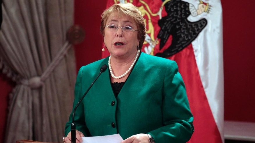 Chile's President Michelle Bachelet announces new Cabinet members at the presidential palace La Moneda, in Santiago, Chile, Monday, May 11,  2015.  (AP Photo/Luis Hidalgo)