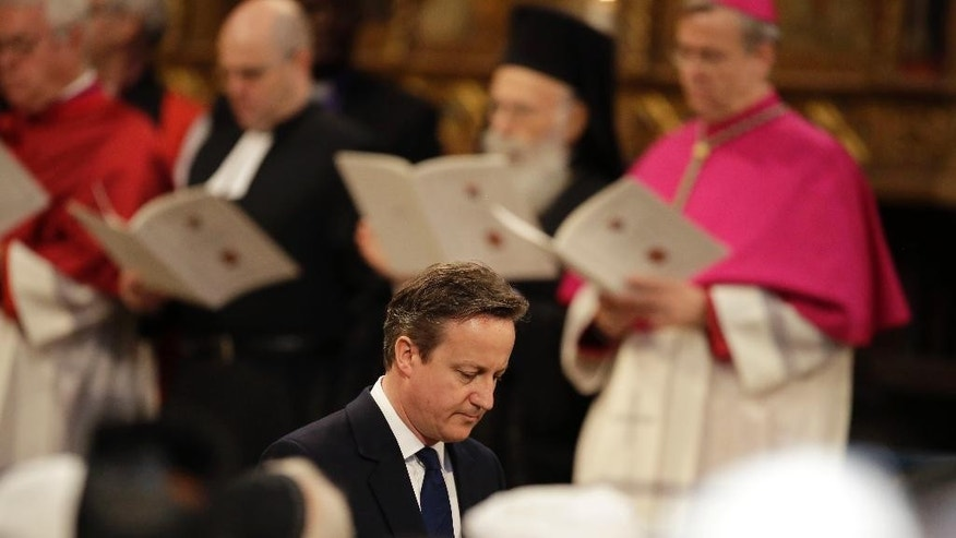 British Prime Minister David Cameron walks away after delivering a reading during a service of thanksgiving to mark the World War II, 70th anniversary of Victory in Europe (VE Day) at Westminster Abbey in London, Sunday, May 10, 2015.  (AP Photo/Matt Dunham, Pool)
